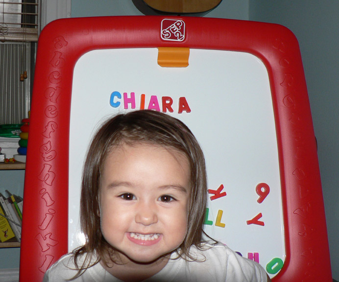 Chiara in front of her 2nd-birthday easel